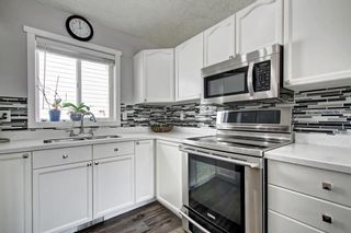 Photo 10: 344 Covewood Park NE in Calgary: Coventry Hills Detached for sale : MLS®# A1100265