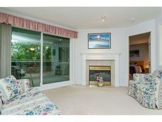 "Photo 5: 322 13880 70 Avenue in Surrey: East Newton Condo for sale in ""Chelsea Gardens"" : MLS®# R2348345"