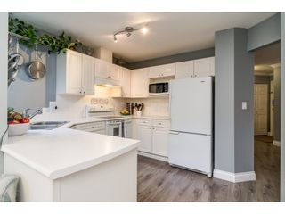 """Photo 7: 112 13900 HYLAND Road in Surrey: East Newton Townhouse for sale in """"Hyland Grove"""" : MLS®# R2336743"""