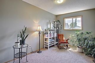 Photo 18: 104 Millview Green SW in Calgary: Millrise Row/Townhouse for sale : MLS®# A1120557