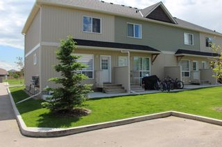 Photo 38: 1404 Clover Link: Carstairs Row/Townhouse for sale : MLS®# A1073804