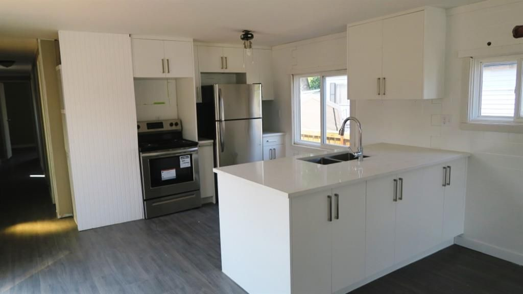 New Kitchen Cabinets & NEW STAINLESS STEEL APPLIANCES.