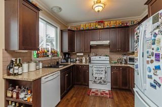 """Photo 13: 34745 3RD Avenue in Abbotsford: Poplar House for sale in """"HUNTINGDON VILLAGE"""" : MLS®# R2580704"""