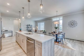 Photo 5: 114 71 Shawnee Common SW in Calgary: Shawnee Slopes Apartment for sale : MLS®# A1099362