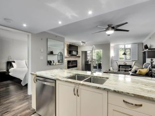 """Photo 12: 201 2665 W BROADWAY in Vancouver: Kitsilano Condo for sale in """"MAGUIRE BUILDING"""" (Vancouver West)  : MLS®# R2580256"""