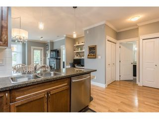 """Photo 7: 401 33338 MAYFAIR Avenue in Abbotsford: Central Abbotsford Condo for sale in """"THE STERLING"""" : MLS®# R2617623"""