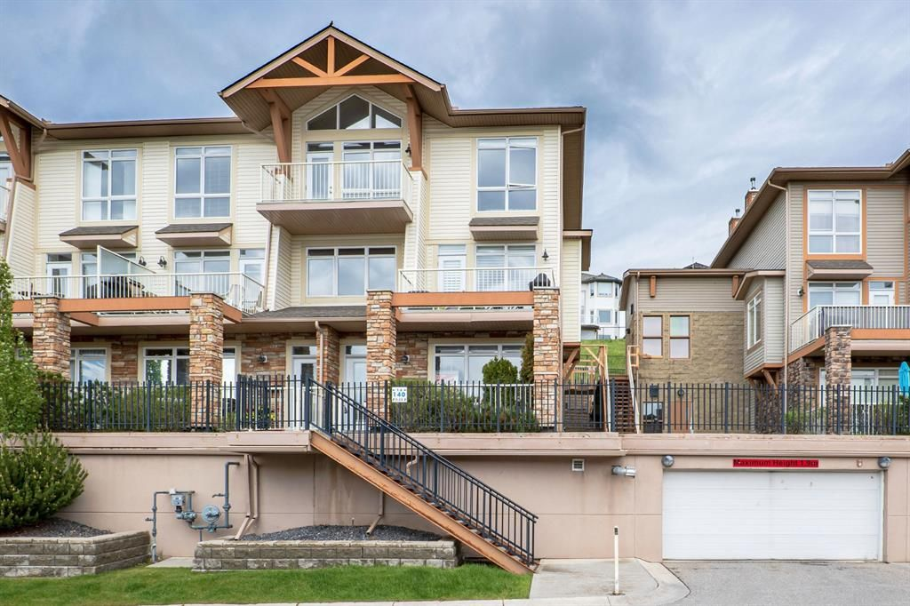 Main Photo: 9 140 Rockyledge View NW in Calgary: Rocky Ridge Row/Townhouse for sale : MLS®# A1118889