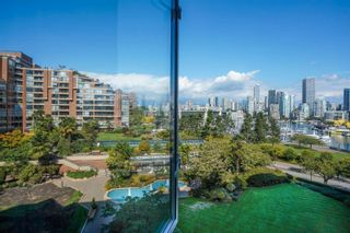 """Photo 2: 405 1490 PENNYFARTHING Drive in Vancouver: False Creek Condo for sale in """"Harbour Cove"""" (Vancouver West)  : MLS®# R2615809"""