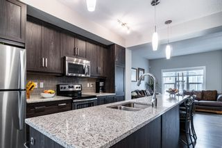 Photo 7: 374 Nolancrest Heights NW in Calgary: Nolan Hill Row/Townhouse for sale : MLS®# A1145723
