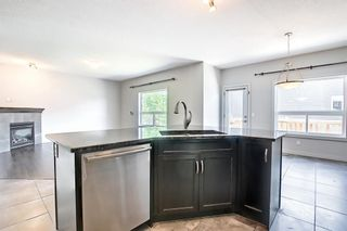 Photo 9: 61 Everhollow Green SW in Calgary: Evergreen Detached for sale : MLS®# A1115077