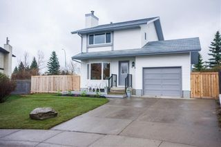 Main Photo: 48 Woodstock Way SW in Calgary: Woodlands Detached for sale : MLS®# A1088011