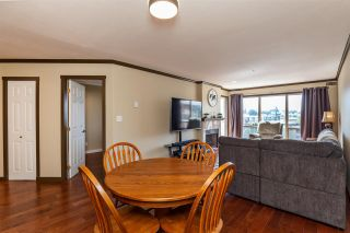 """Photo 11: 410 33731 MARSHALL Road in Abbotsford: Central Abbotsford Condo for sale in """"Stephanie Place"""" : MLS®# R2590546"""