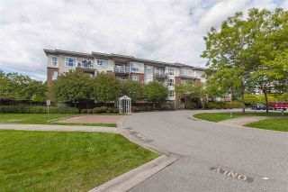 "Photo 1: 404 15885 84 Avenue in Surrey: Fleetwood Tynehead Condo for sale in ""Abbey Road"" : MLS®# R2372241"