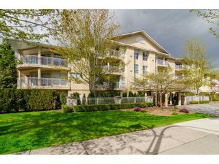 "Photo 1: 412 13727 74 Avenue in Surrey: East Newton Condo for sale in ""King's Court"" : MLS®# R2157470"