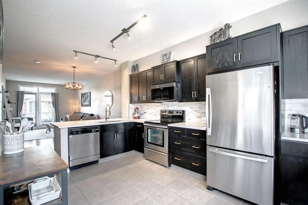 Main Photo: 1103 125 Panatella Way NW in Calgary: Panorama Hills Row/Townhouse for sale : MLS®# A1143179