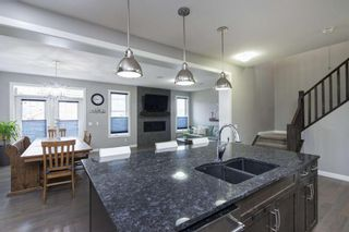 Photo 7: 419 Evansglen Drive NW in Calgary: Evanston Detached for sale : MLS®# A1095039