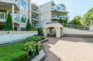 """Photo 2: 102 1220 LASALLE Place in Coquitlam: Canyon Springs Condo for sale in """"Mountainside Place"""" : MLS®# R2202260"""