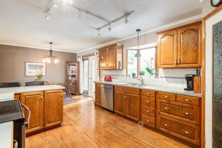 Photo 10: 28 Kelvin Place SW in Calgary: Kingsland Detached for sale : MLS®# A1079223