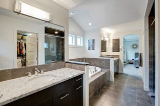 Photo 21: 127 Springbluff Boulevard SW in Calgary: Springbank Hill Detached for sale : MLS®# A1140601