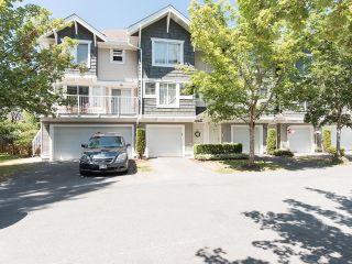 Photo 1: 63 20760 DUNCAN Way: Townhouse for sale in Langley: MLS®# R2604327