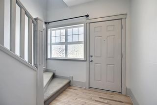 Photo 3: 63 Wentworth Common SW in Calgary: West Springs Row/Townhouse for sale : MLS®# A1124475