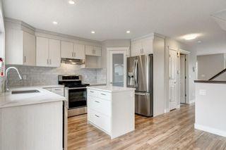 Photo 2: 102 HIDDEN RANCH Road NW in Calgary: Hidden Valley Detached for sale : MLS®# C4294129
