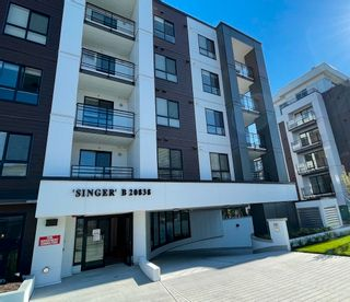 """Photo 1: 402B 20838 78B Avenue in Langley: Willoughby Heights Condo for sale in """"Hudson & Singer"""" : MLS®# R2594495"""