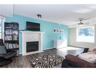 Photo 4: 8 SUN RIDGE Close NW: Airdrie House for sale : MLS®# C4048800