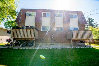 Photo 1: 12016 12018A 69 Street in Edmonton: Zone 06 House Duplex for sale : MLS®# E4256657