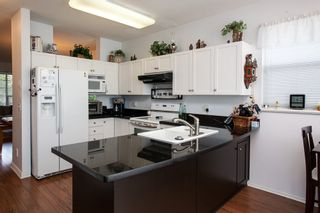 """Photo 10: 8688 207 Street in Langley: Walnut Grove House for sale in """"Discovery Towne"""" : MLS®# R2077292"""