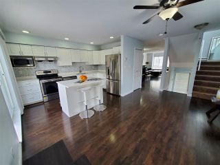 """Photo 6: 28 16388 85 Avenue in Surrey: Fleetwood Tynehead Townhouse for sale in """"CAMELOT"""" : MLS®# R2555638"""