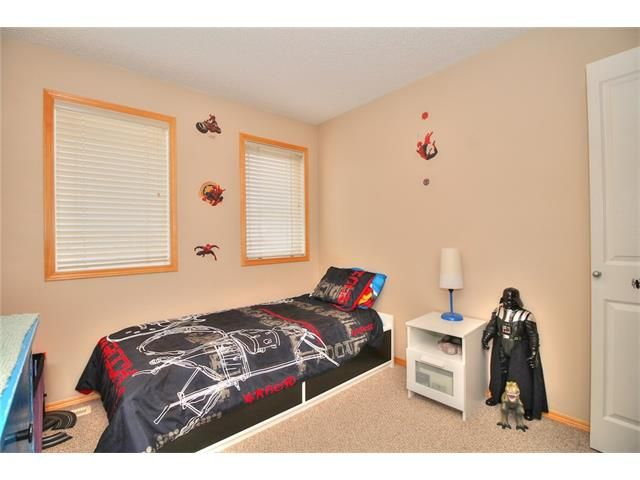 Photo 19: Photos: 304 EVERSYDE Circle SW in Calgary: Evergreen House for sale : MLS®# C4035934