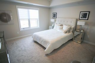 Photo 18: Gorgeous corner unit with wrap around balcony. 1 Underground parking stall included. Pet friendly building.