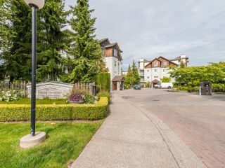 """Photo 2: 104 10188 155 Street in Surrey: Guildford Condo for sale in """"Sommerset"""" (North Surrey)  : MLS®# R2467680"""