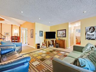 Photo 26: 75 Anatapi Lane SW in Calgary: Springbank Hill Detached for sale : MLS®# A1099057