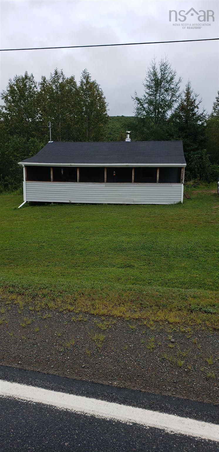 Main Photo: 6948 Cabot Trail Road in North East Margaree: 306-Inverness County / Inverness & Area Residential for sale (Highland Region)  : MLS®# 202123100