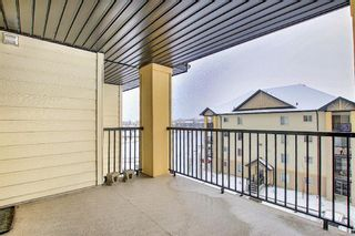 Photo 26: 7402 304 MacKenzie Way SW: Airdrie Apartment for sale : MLS®# A1081028