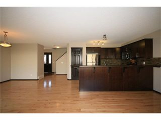 Photo 8: 81 SUNSET Heights: Cochrane House for sale : MLS®# C4072364