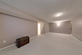 Photo 29: 38 1008 Woodside Way NW: Airdrie Row/Townhouse for sale : MLS®# A1123458