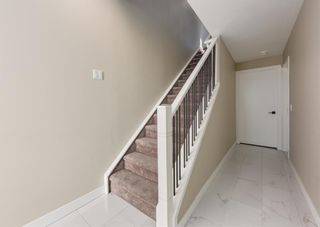 Photo 3: 1956 19 Street NW in Calgary: Banff Trail Row/Townhouse for sale : MLS®# A1071030