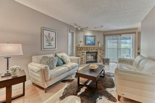 Photo 1: 85 Coachway Gardens SW in Calgary: Coach Hill Row/Townhouse for sale : MLS®# A1110212