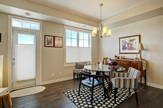 Photo 7: 82 Cranbrook Drive SE in Calgary: Cranston Row/Townhouse for sale : MLS®# A1075225