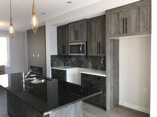 Photo 20: 23 Sunrise Heights: Cochrane Duplex for sale : MLS®# A1017998