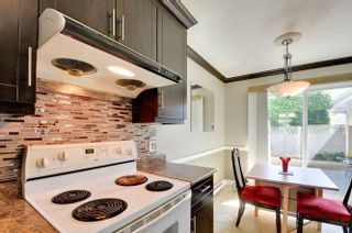 Photo 8: 10 9540 PRINCE CHARLES Boulevard in Surrey: Queen Mary Park Surrey Townhouse for sale : MLS®# R2162922