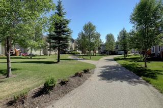Photo 29: 76 Bridleridge Manor SW in Calgary: Bridlewood Row/Townhouse for sale : MLS®# A1106883