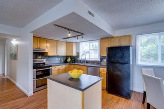Photo 10: 403 1540 29 Street NW in Calgary: St Andrews Heights Row/Townhouse for sale : MLS®# A1135338