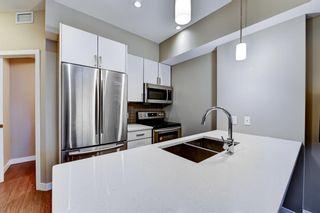 Photo 6: 211 28 Auburn Bay Link SE in Calgary: Auburn Bay Apartment for sale : MLS®# A1076356