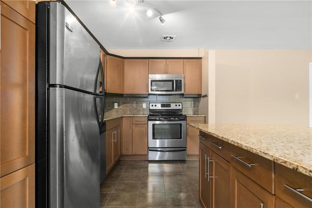 Photo 7: Photos: 406 565 Corydon Avenue in Winnipeg: Condominium for sale (1B)  : MLS®# 202025502