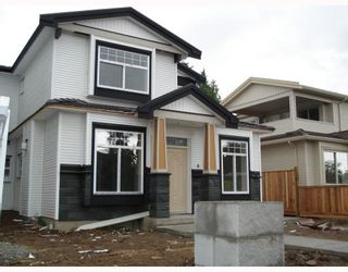 Photo 1: 7152 CANADA Way in Burnaby: Burnaby Lake 1/2 Duplex for sale (Burnaby South)  : MLS®# V764368