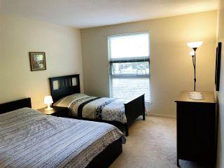 """Photo 14: 108 15288 100 Avenue in Surrey: Guildford Condo for sale in """"CEDAR GROVE"""" (North Surrey)  : MLS®# R2472138"""